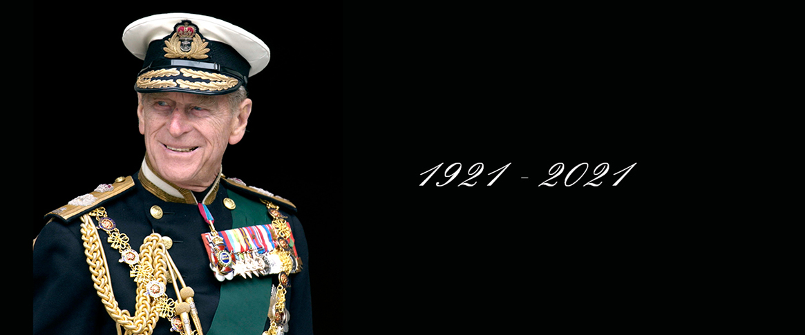 A smiling elderly Prince Philip in full dress uniform with a lifespan from 1921 to 2021.