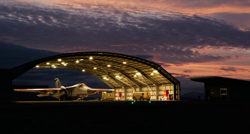F-111 in a hangar at dusk