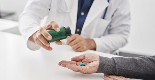 Doctor gives medicine to a patient